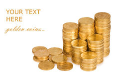 Golden coins isolated on white Stock Photos