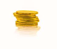 Golden coins isolated on white Royalty Free Stock Photography