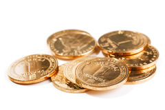 Golden coins isolated on white Royalty Free Stock Image