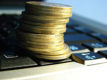 Golden coins on laptop Royalty Free Stock Photography