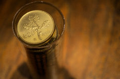 Golden coins. Old italian lira. Vintage golden coind on wooden table Royalty Free Stock Photos