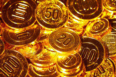 Golden coins piled in a heap of background stock photo