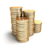 Golden coins in piles. Royalty Free Stock Image