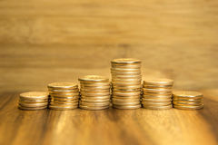 Golden coins piles Royalty Free Stock Image