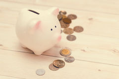 Golden coins and a pink piggy bank. Japanese Yen. Stock Photography