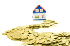 Golden coins and road to house Stock Photos