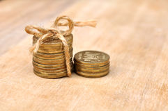Golden Coins With Rope On Wood Table Royalty Free Stock Images