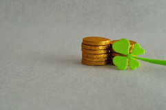 Golden coins with a shamrock royalty free stock image
