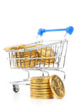 Golden coins in shopping cart Stock Images