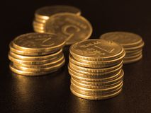 Golden coins stacks. Sepia toned some coins stacks on black Royalty Free Stock Photo