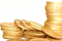 Golden coins on white background. Macro Royalty Free Stock Photos