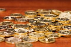 Golden coins on a wooden table. Close up Royalty Free Stock Photos