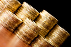 Golden coins On a wooden table Royalty Free Stock Photography