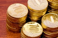 Golden coins on a wooden table close up Stock Photography