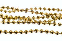 Golden color beads Stock Photos