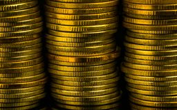 Golden color coin stacks on dark background with copy space for text. Business and finance growth, saving money, investment and in Stock Photography