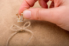 Golden color crown model with fake pearls Royalty Free Stock Photography