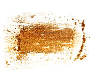Golden color crushed eyeshadow isolated on white background. Royalty Free Stock Photography