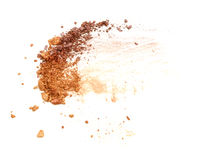 Golden color crushed eyeshadow isolated on white background. Royalty Free Stock Images