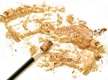 Golden color crushed powder make up with blush cosmetic. Golden color crushed powder make up with blush cosmetic Royalty Free Stock Photography