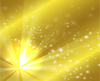 A golden color design with a burst and rays Royalty Free Stock Photos