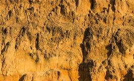 Golden Color Dirt Cliff Stock Photo