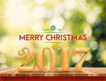 Golden color 2017 Happy New Year (3d rendering) on brown wood ta Stock Images