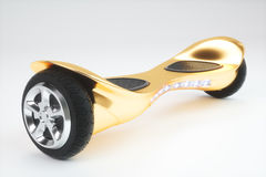 Golden color hoverboard on white. 3D rendering Royalty Free Stock Photography