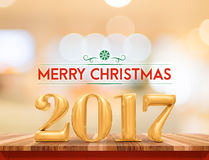 Golden color 2017 Merry christmas (3d rendering) on brown wood t royalty free stock photos