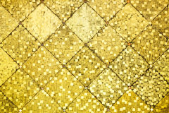 Golden color oriental antique style tiles wall Stock Photo