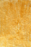 Golden color painted crinkled paper. As background Stock Photo