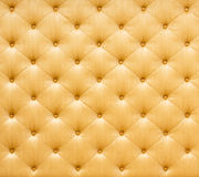 Golden color sofa cloth texture Stock Images