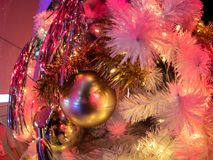 The golden color on the white christmas tree decoration with the Royalty Free Stock Photography