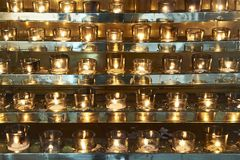 Golden colored candles contrasting with silver stripes stock photography
