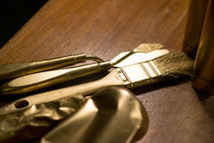 Golden colored close up of brush and spatula Stock Photography