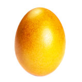 Golden colored Easter  Egg isolated on white background close up Royalty Free Stock Photo