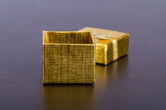 Golden Colored Gift Box on Table. Open, golder colored gift box on wooden table stock photography
