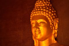 Golden colored idol of lord Buddha stock image