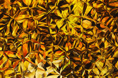 Golden colored relief crystal backgrounds. Golden colored relief crystal background Stock Image