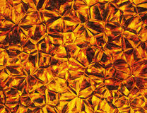 Golden colored relief crystal fire backgrounds Stock Photo