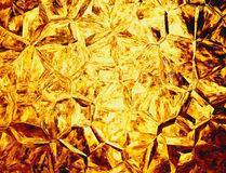 Golden colored relief crystal fire backgrounds Royalty Free Stock Images