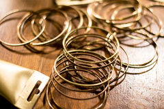 Golden colored rings spread all over and a part of a tube Stock Photo