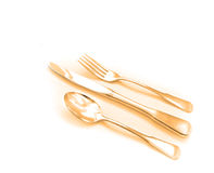 Golden Colored Silverware Stock Photo