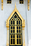 Golden  colored window of temple in Thailand Stock Image