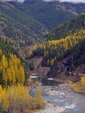 Golden Colors Along the Middle Fork. This image of the Middle Fork of the Flathead, the railroad tracks, the railroad tunnel and the forest with the golden Royalty Free Stock Photos