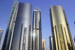 Golden colour tower in dubai. Jumeirah lake towers Royalty Free Stock Photography