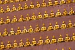 Golden Coloured Buddhist statue at Wat Thum Pu Wa Stock Photo