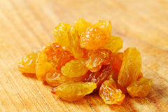 Golden-coloured dried grapes Stock Image