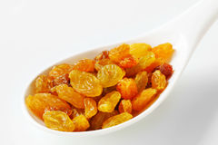 Golden-coloured dried grapes Royalty Free Stock Image