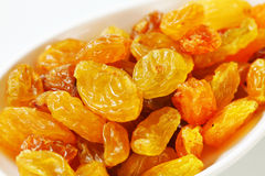 Golden-coloured dried grapes Royalty Free Stock Photography